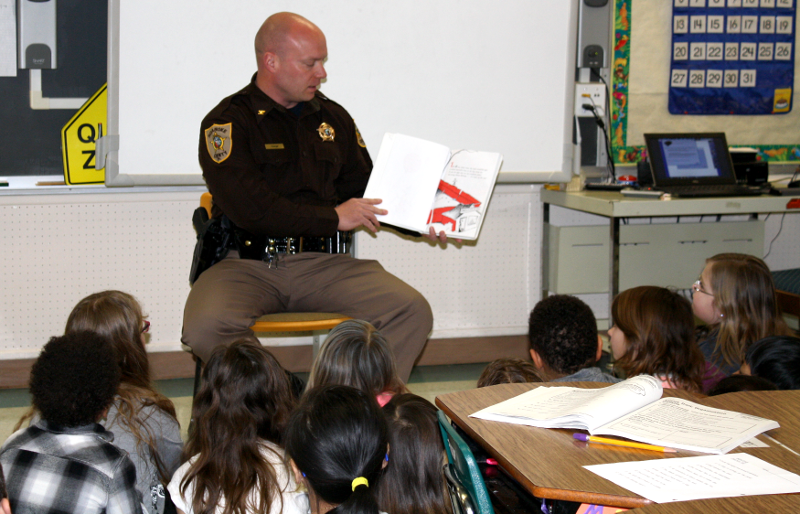 Sheriff Orange Reading Book to Students